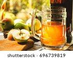 apples  apple cider ale in beer ... | Shutterstock . vector #696739819