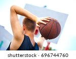 male playing basketball outdoor | Shutterstock . vector #696744760