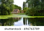 english mill pond and watermill. | Shutterstock . vector #696763789