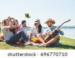 happy young friends having... | Shutterstock . vector #696770710