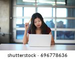 a young asian teenager... | Shutterstock . vector #696778636