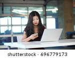 a portrait of a distracted... | Shutterstock . vector #696779173