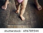 happy baby learning to walk... | Shutterstock . vector #696789544
