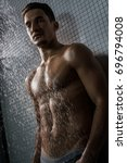 muscular shirtless man shot in...   Shutterstock . vector #696794008