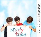 three school boys holding white ... | Shutterstock . vector #696803080