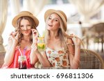 two happy beautiful girls... | Shutterstock . vector #696811306