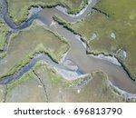 narrow channels wind through a... | Shutterstock . vector #696813790