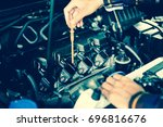 close up hands checking lube... | Shutterstock . vector #696816676