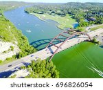 Small photo of Aerial view Pennybacker Bridge or 360 Bridge, a landmark in Austin, Texas, US. Variety of high speed boat, yacht, jet ski on Colorado River and car traffic. Downtown skyscrapers are on the far left.