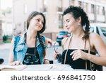 two beautiful tourist girls... | Shutterstock . vector #696841750