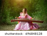 beautiful chinese woman sitting ... | Shutterstock . vector #696848128