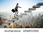businesswoman climbing career... | Shutterstock . vector #696852400