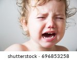 the little curly little girl is ... | Shutterstock . vector #696853258