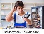 computer repairman repairing... | Shutterstock . vector #696855364