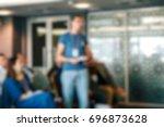 blur of business meeting in... | Shutterstock . vector #696873628