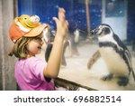 young caucasian girl watching... | Shutterstock . vector #696882514