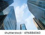 a group of modern skyscrapers... | Shutterstock . vector #696886060