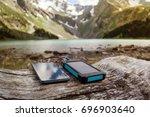 battery solar energy device on... | Shutterstock . vector #696903640