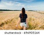 a beautiful girl is walking... | Shutterstock . vector #696905164
