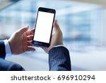 businessman using smartphone.... | Shutterstock . vector #696910294