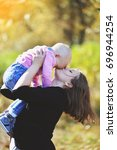 a young mother walks with a...   Shutterstock . vector #696944254