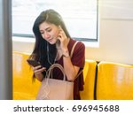 asian woman passenger with... | Shutterstock . vector #696945688