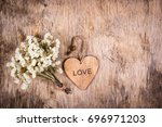 Wooden Heart And White Flowers...