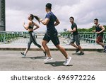 asian young people running on... | Shutterstock . vector #696972226