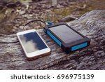 solar power bank charging smart ... | Shutterstock . vector #696975139