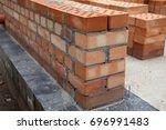 construction of houses  masonry ... | Shutterstock . vector #696991483