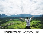 a man raising hand up on... | Shutterstock . vector #696997240