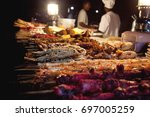 night street seafood in stone... | Shutterstock . vector #697005259