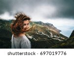 joyful young woman with flying... | Shutterstock . vector #697019776