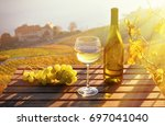 wine and grapes. lavaux region... | Shutterstock . vector #697041040
