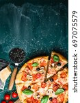 traditional italian pizza on a... | Shutterstock . vector #697075579