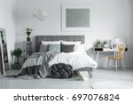 pile of books placed on the... | Shutterstock . vector #697076824