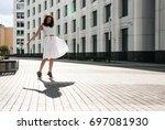brunette in white dress dancing ... | Shutterstock . vector #697081930