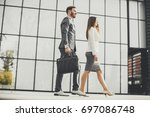 young business couple walking... | Shutterstock . vector #697086748