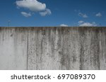 Concrete Wall Against A Blue...