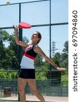Small photo of Woman playing padel outdoor