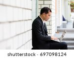 casual businessman using laptop ... | Shutterstock . vector #697098124