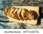 fresh bread slice and cutting... | Shutterstock . vector #697110376