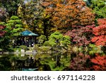colorful autumn trees with pond ... | Shutterstock . vector #697114228