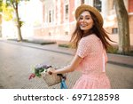 smiling happy girl in dress and ... | Shutterstock . vector #697128598