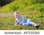 little girl lies on grass in...   Shutterstock . vector #697132300