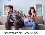 young family in broken... | Shutterstock . vector #697134223