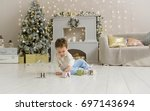 cute toddler playing with his... | Shutterstock . vector #697143694