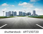 modern skyline and empty road | Shutterstock . vector #697150720