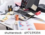 messy and cluttered office desk | Shutterstock . vector #697159354