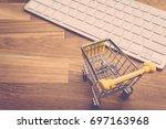 model empty trolley on wooden... | Shutterstock . vector #697163968